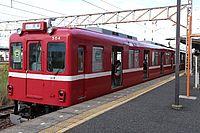 train, track, transport, sky, outdoor, red, land vehicle, vehicle, platform, tram, railroad, rail, station, traveling, pulling, engine