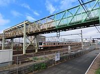 sky, outdoor, train, building, track, rail, bridge, station, vehicle, land vehicle, cloud, traveling, railroad