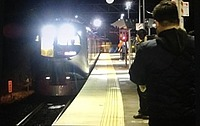 train, station, person, text, vehicle
