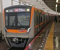 train, track, platform, transport, station, land vehicle, vehicle, public transport, train station, text, railway, rail, rolling stock, railroad, passenger car, orange, pulling