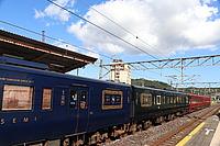 sky, train, track, transport, outdoor, rail, land vehicle, vehicle, locomotive, platform, station, rolling stock, pulling, traveling, railroad, day