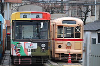 outdoor, land vehicle, transport, vehicle, tram, text, bus, city, train