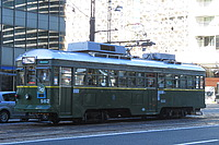 road, outdoor, transport, land vehicle, vehicle, street, train, tram, city