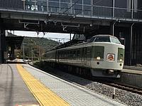 train, track, building, platform, station, rail, outdoor, land vehicle, vehicle, transport, locomotive, railway, rolling stock, pulling, traveling, railroad
